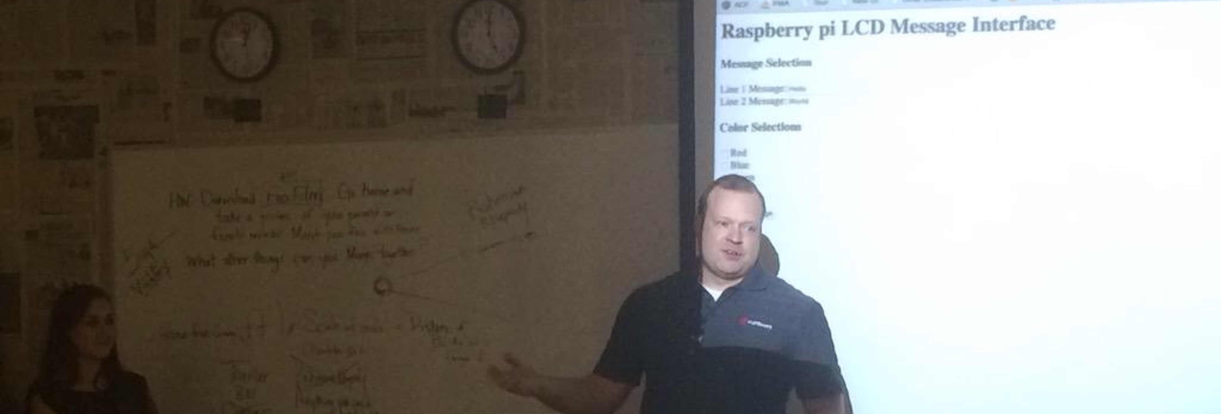 Chris Kreider presenting simple programs using the Raspberry Pi during STEM week at a local academy